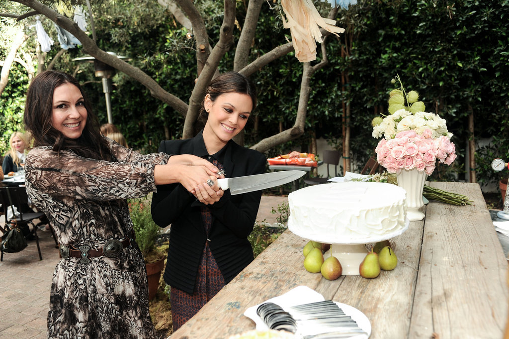 Rachel Bilson and Nicole Chavez cut the cake.