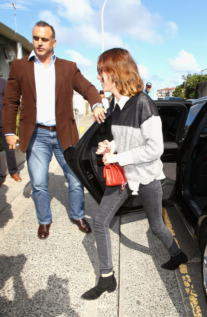 On the ground in Sydney in a colour-blocked knit + skinny jeans in August of 2011.