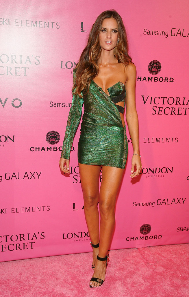 Izabel Goulart donned a supersexy, one-shouldered minidress and ankle-strap heels.