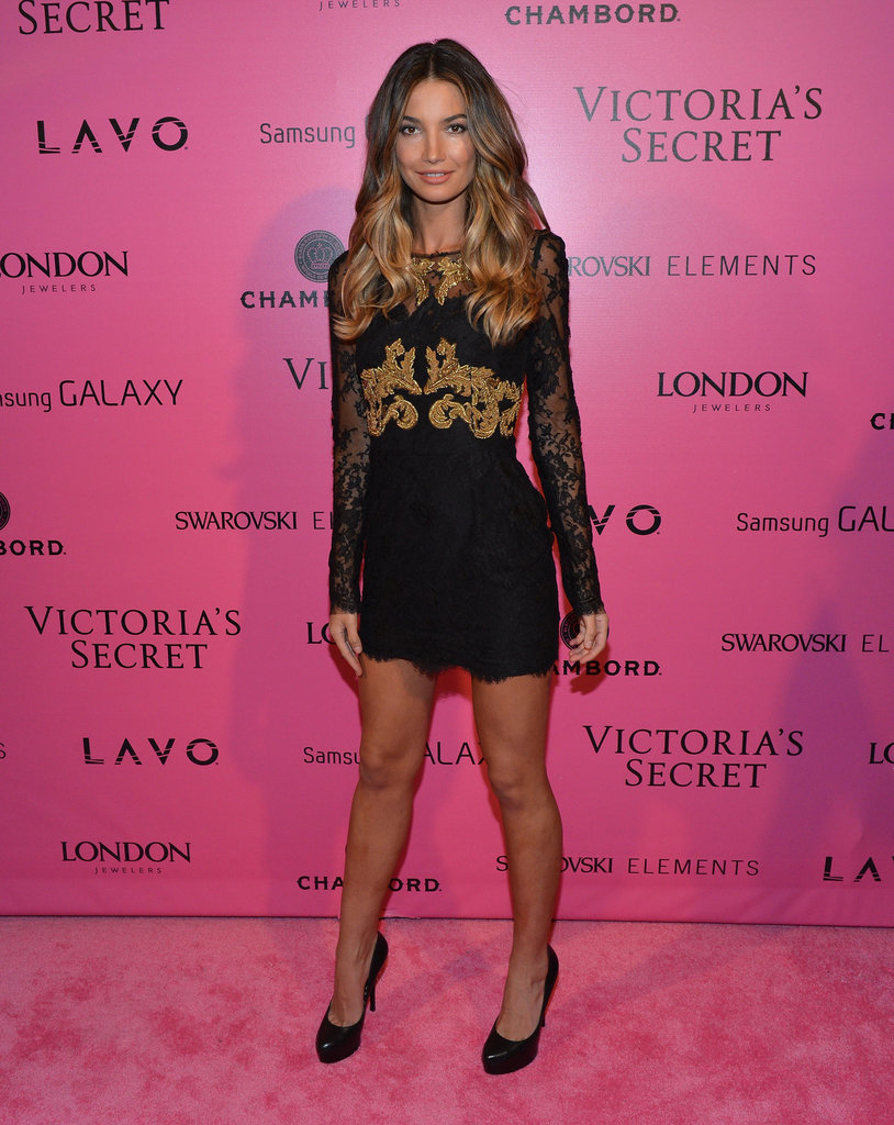 Lily Aldridge traded her wings for an LBD with gold embellishments and a pair of black pumps.