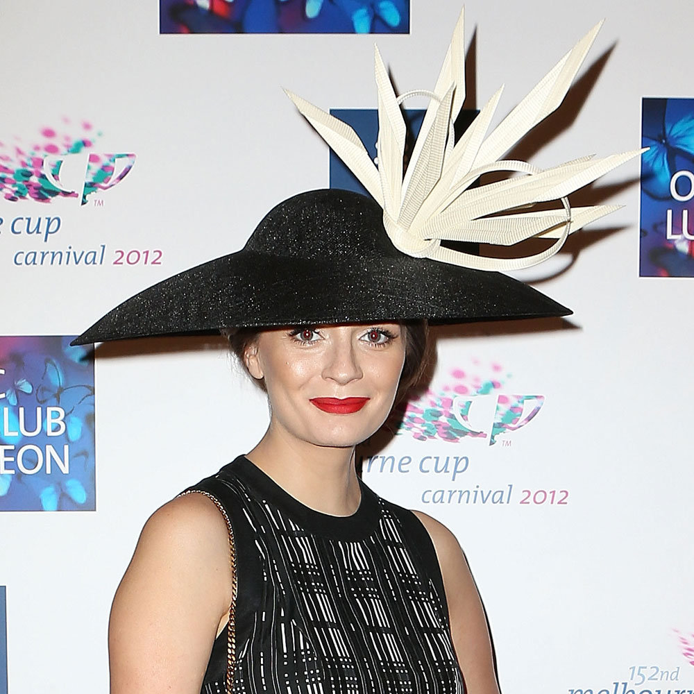 Her black and white hat is pretty striking and when that's the case, it's best to keep hairstyling to a minimum.