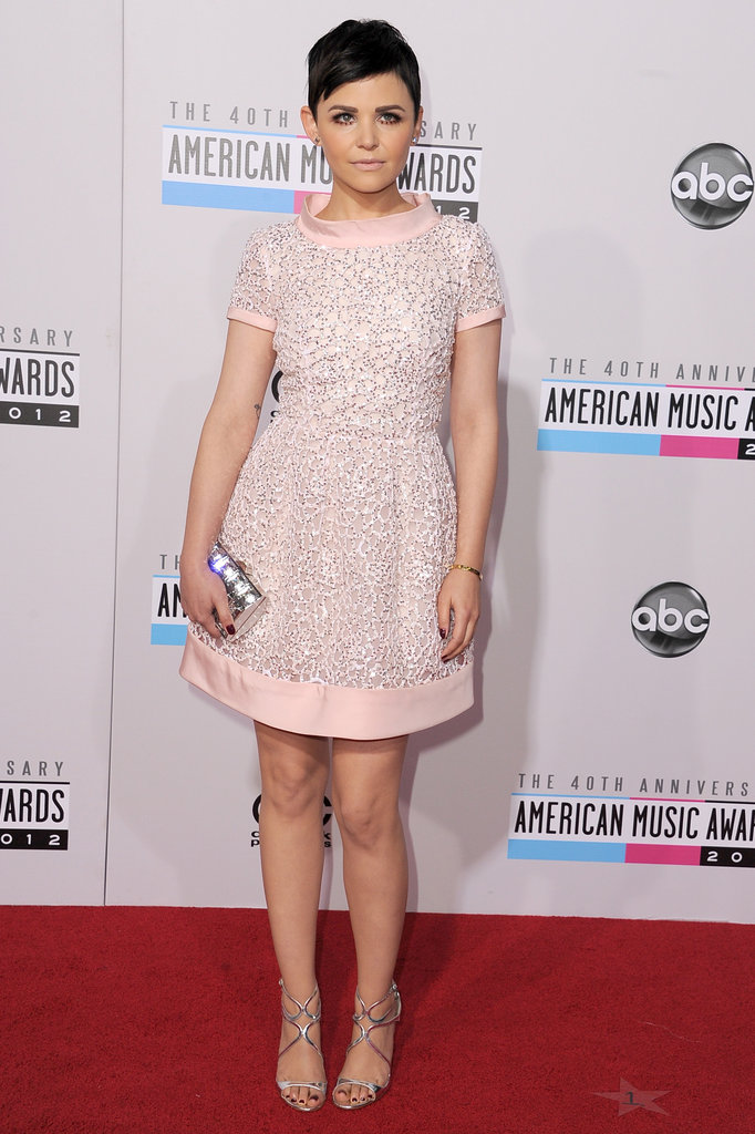 Ginnifer Goodwin opted for retro embellishments by way of Oscar de la Renta's soft-pink beaded Resort '13 dress. She finished off the look with a hologram-silver clutch and matching strappy Jimmy Choo sandals.