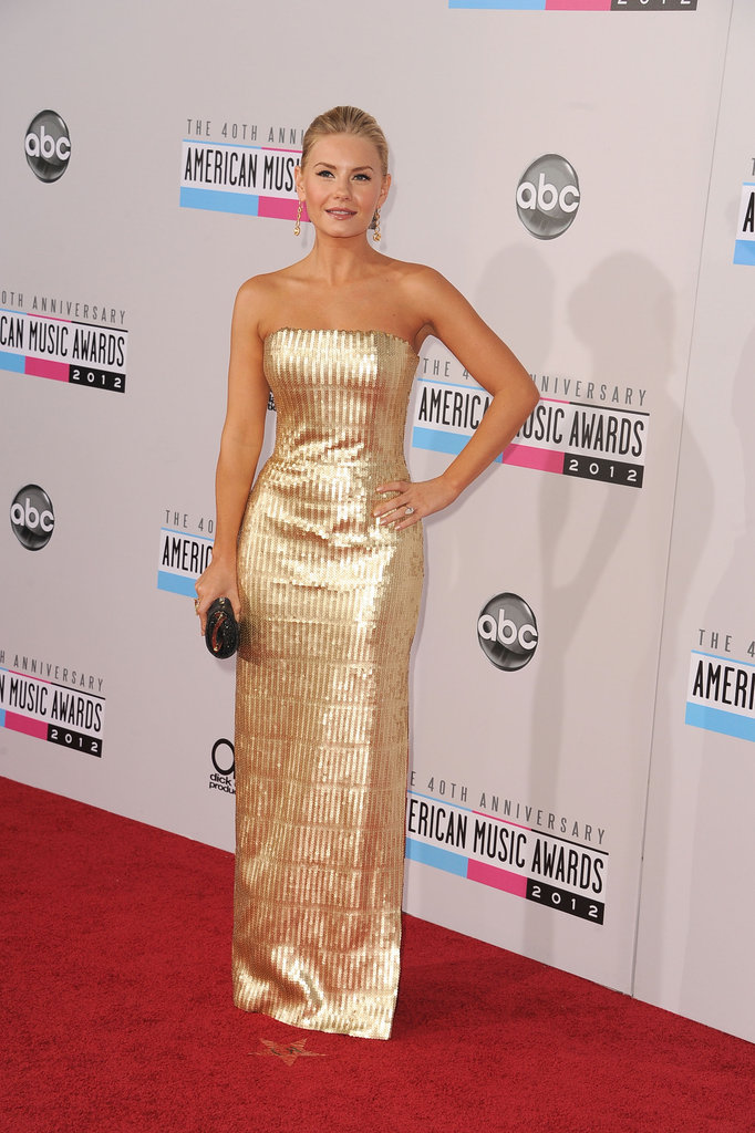 Elisha Cuthbert stepped out in a stunning gold strapless gown.