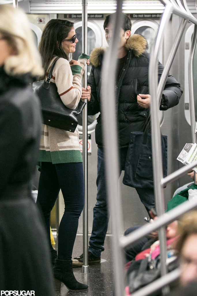 Katie Holmes rode in the subway with a male friend.