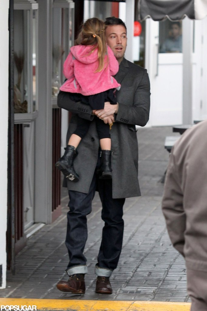 Ben Affleck carried Seraphina Affleck, who wore a pink coat.