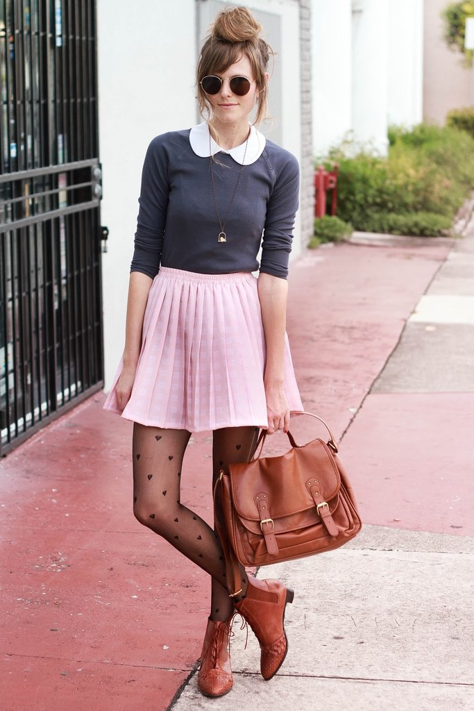 Channel a girlie Winter style with sweet tights and a pleated skirt — extra points for a Peter Pan collar peeking out from your sweater. Source: Lookbook.nu