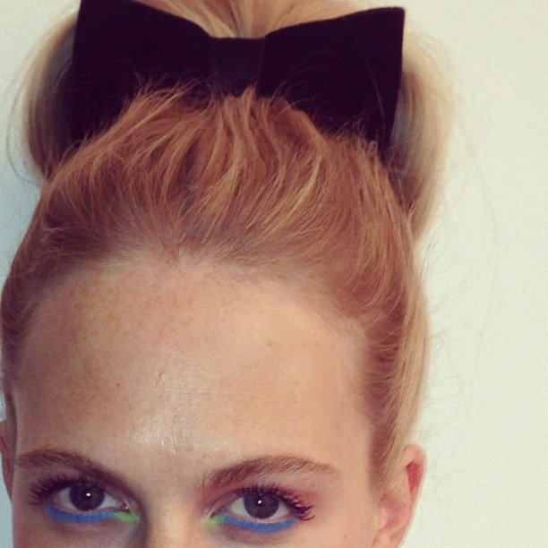 Poppy Delevingne shared a photo of her colorful eye makeup and adorable bow. Source: Instagram user poppydelevingne