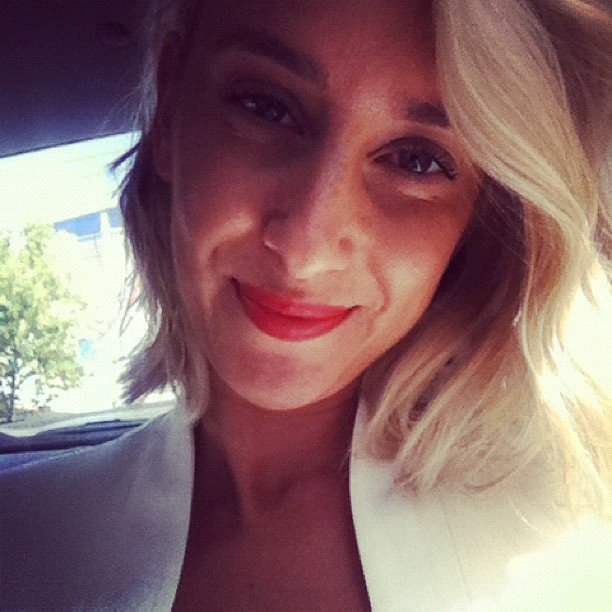 This is Alison's serene face, masking the terror of mixing red lipstick with a white blazer.