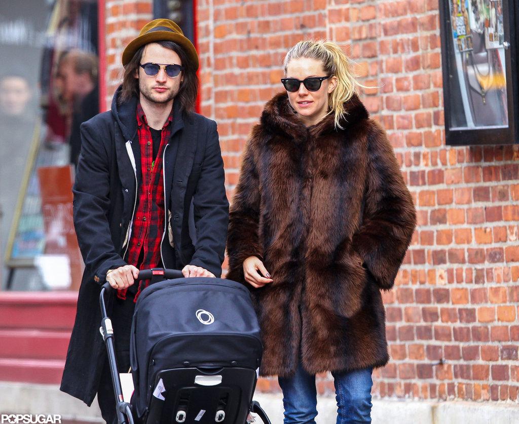 Sienna Miller and Tom Sturridge walked with daughter Marlowe.