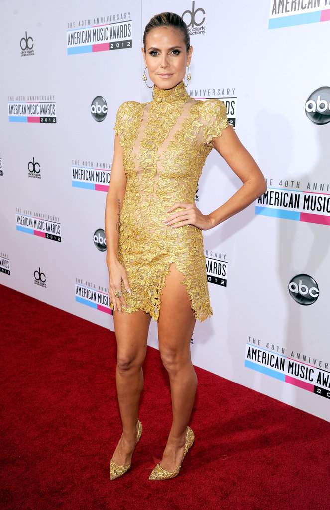 Heidi Klum proved that even the most Victorian-inspired gold lace minidress can be sultry; just add a thigh-high slit.