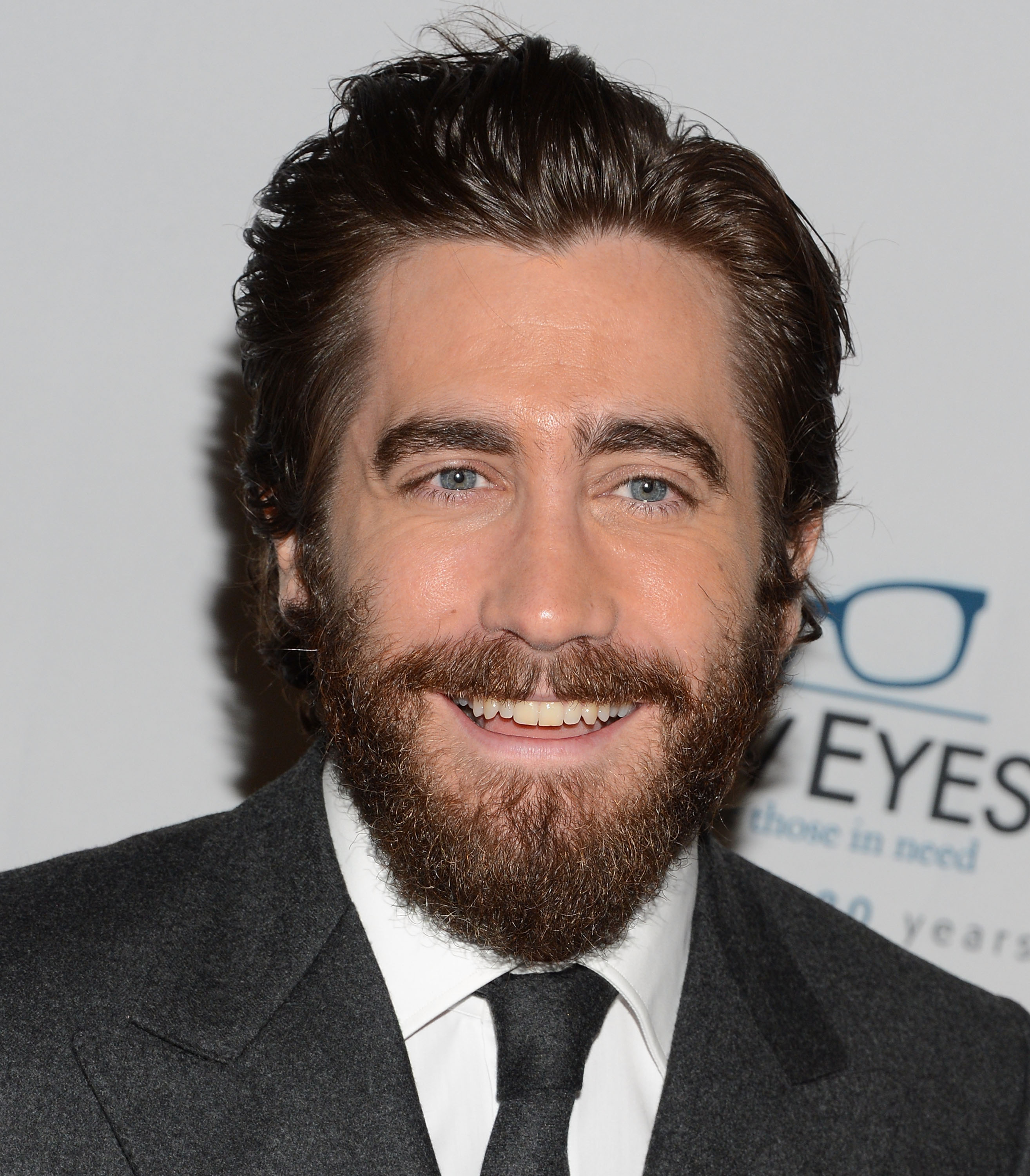 Jake Gyllenhaal flashed a bright smile for photographers.