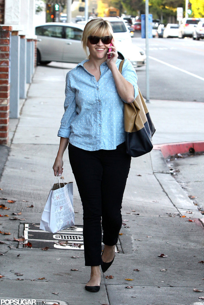 Reese Witherspoon toted a shopping bag.