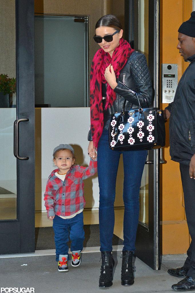 Miranda Kerr and Flynn Bloom made their way onto the sidewalk in NYC.