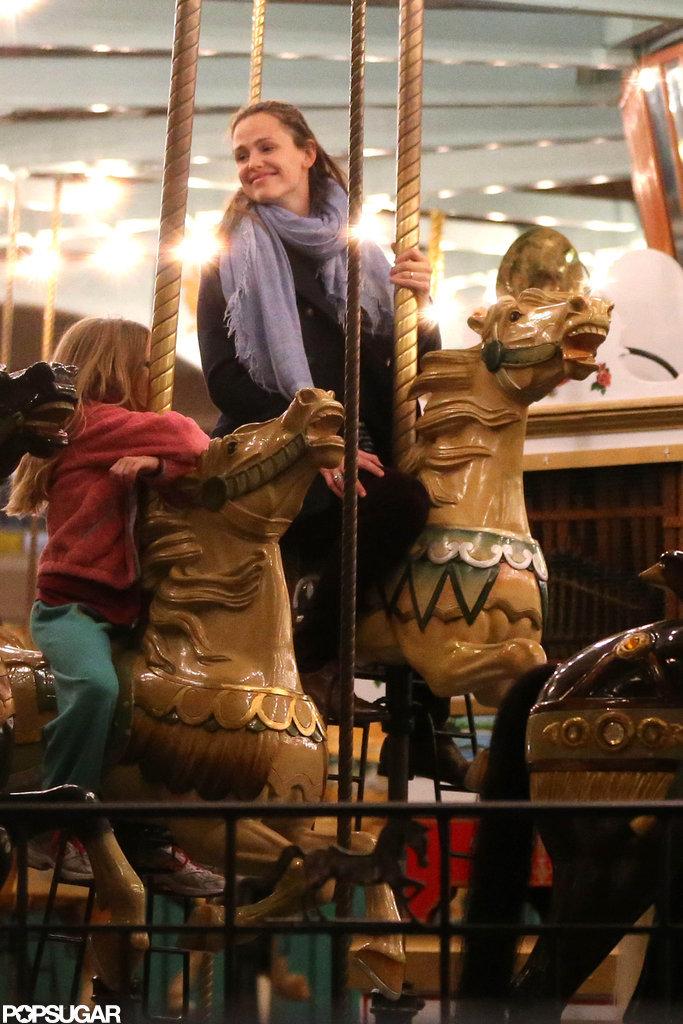 Jennifer Garner took Violet and Seraphina Affleck on the merry-go-round.