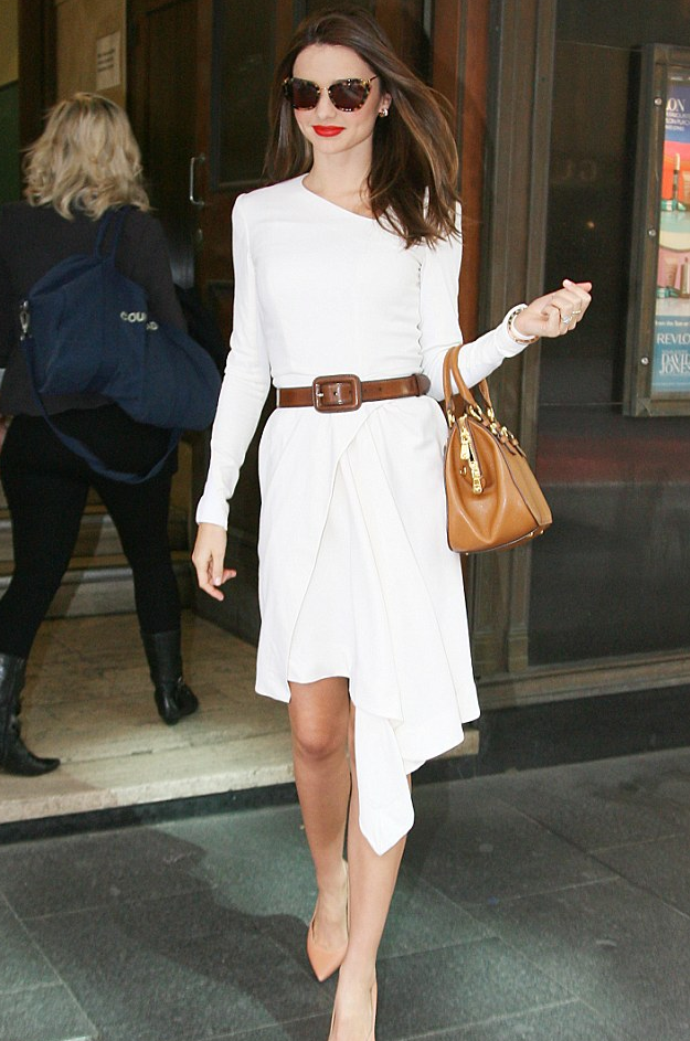 Miranda worked her tortoiseshell pair back with a chic white dress and neutral accessories back in August in Sydney.
