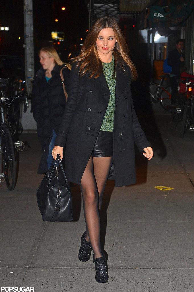 Miranda Kerr toted an oversize bag.