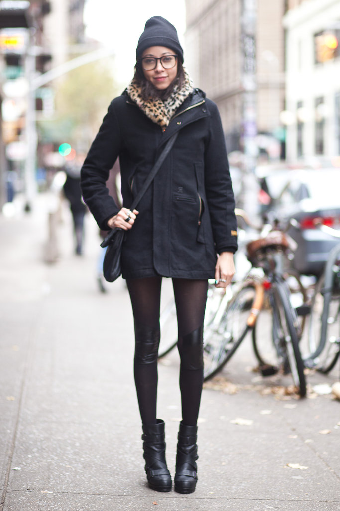 Give your Winter coat some personality — a pair of cool-girl boots, a knit beanie, and geeky-chic specs do the trick here. Source: Adam Katz Sinding