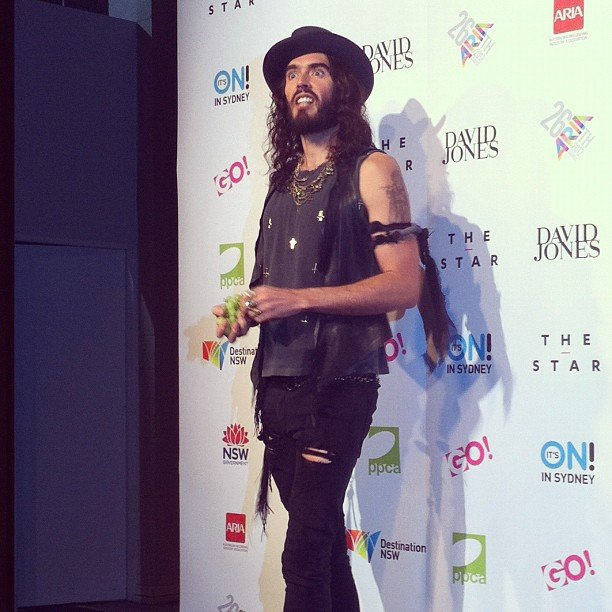 British comedian Russell Brand threw grapes at the media (including us!) backstage at the ARIA awards.