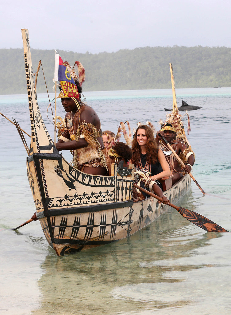 Prince William and Kate were followed by locals dressed as sharks as they traveled in a traditional canoe during a visit to Tavanipupu Island in September.