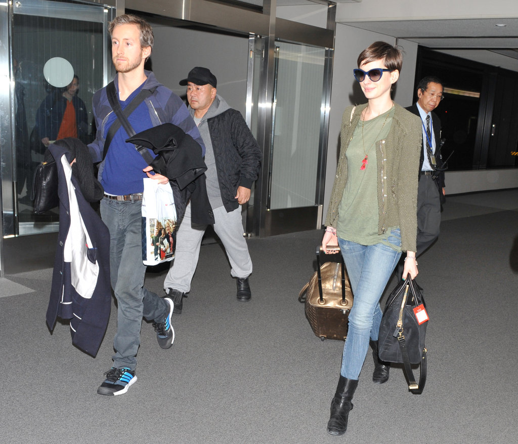 Anne Hathaway keeps a soft cardigan on call when travelling.