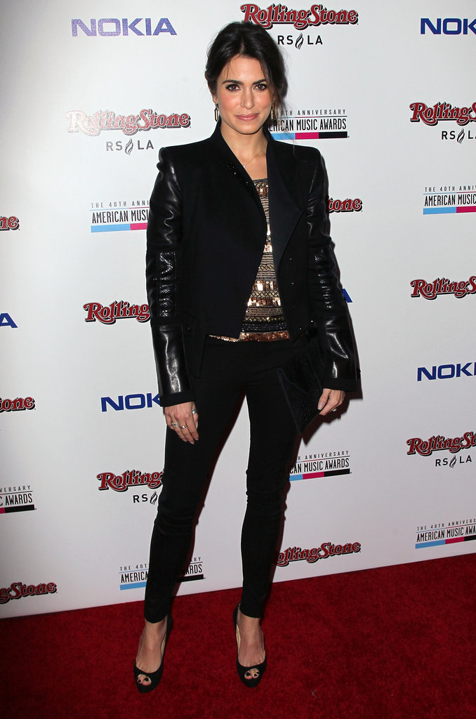 If you're not one for getting all gussied up, then look to Nikki Reed's cool-girl mix of sparkles, leather, and basic black skinnies for a night out.