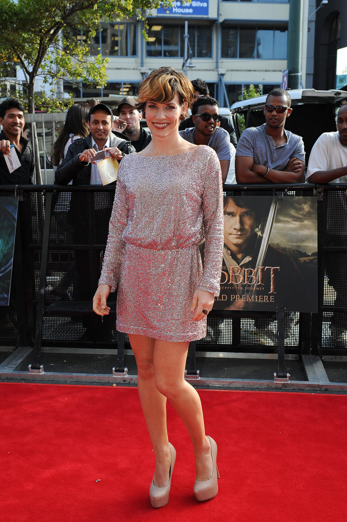 Evangeline Lilly showed off a quintessential kind of holiday look in a silver, sequined mini on The Hobbit red carpet.