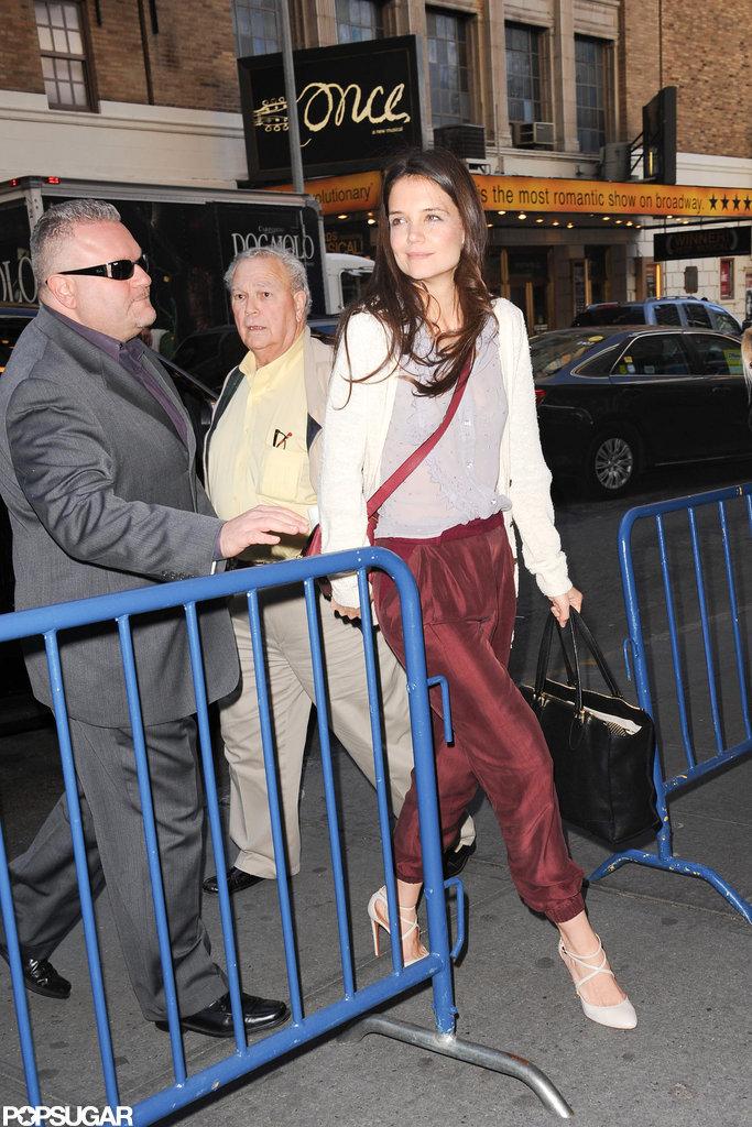 Katie Holmes sported burgundy pants.