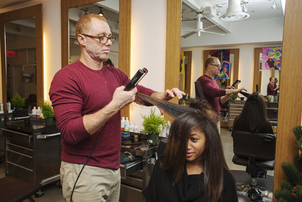 """Next, Dickey used a flat iron to smooth, but not too perfectly. """"Doing a hardcore blow-dry, then going over it with a flat iron is just too much heat,"""" he said. So forget about trying to achieve stick-straight strands, and maintain a bit of body and texture instead."""