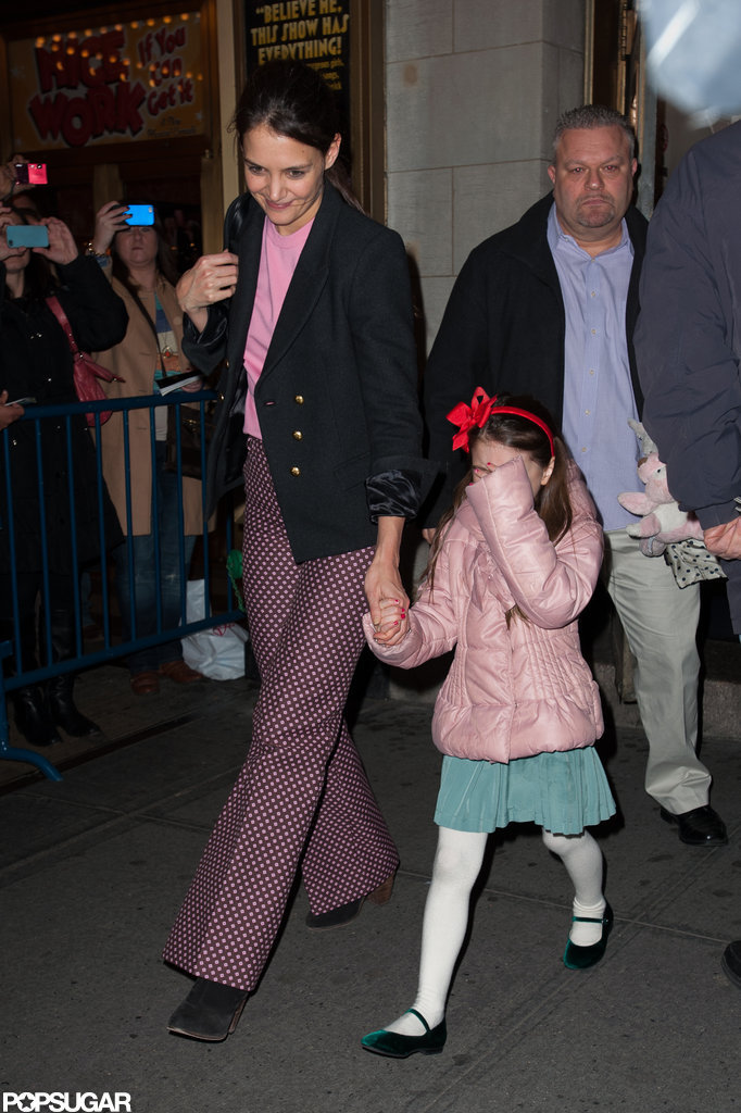 Katie Holmes held Suri Cruise's hand on the way to her Broadway show.