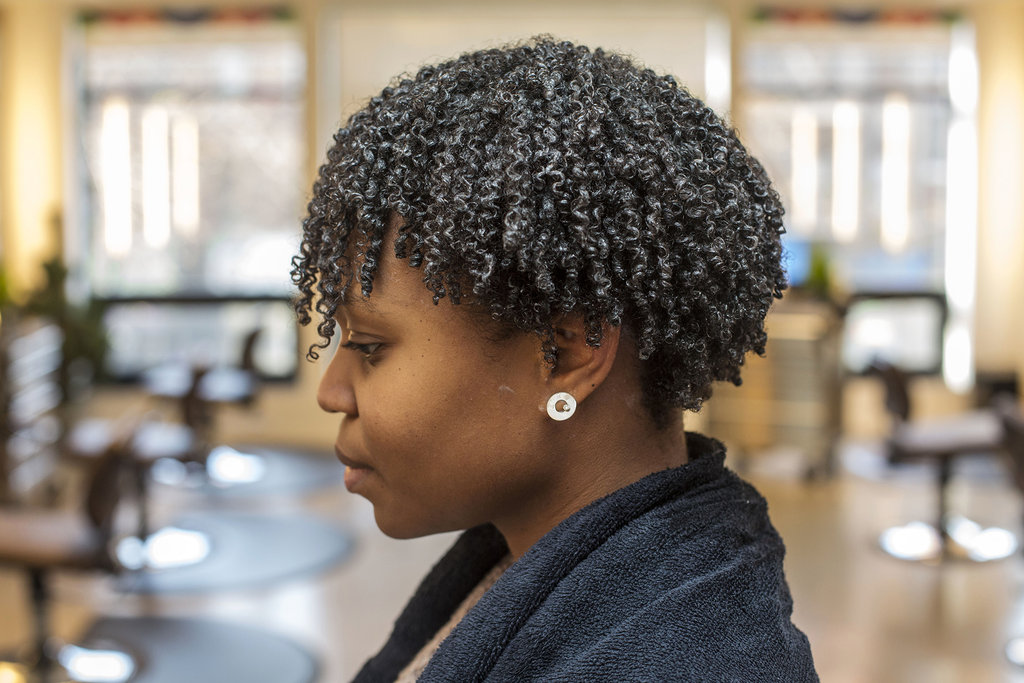 In order to distribute the product throughout the hair, rinse the entire head with a splash of water. Then, bend over and shake furiously. This will help separate curls, and each hair will fall naturally into place when you flip back over. Sit under a hood dryer until hair is completely dry (about 30 minutes).