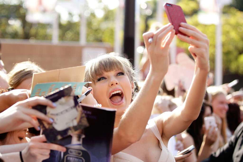 She took photos with her fans while arriving at the ARIA Awards in November 2012.