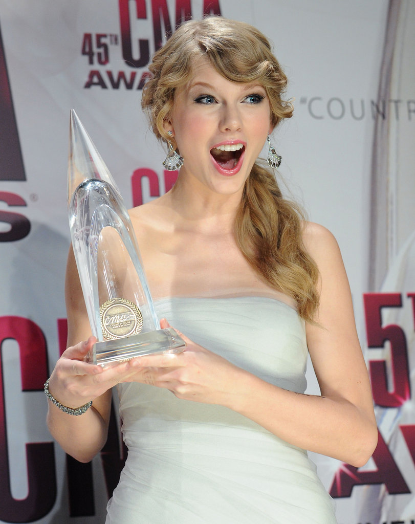 Taylor posed in the press room at the CMA Awards in November 2011.
