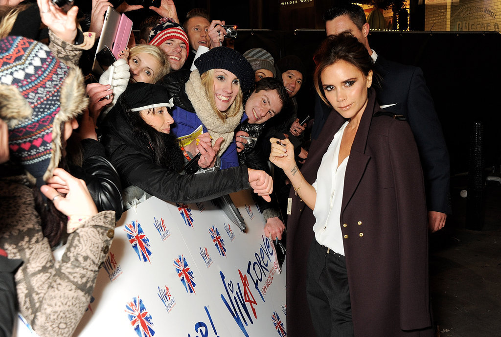 Victoria Beckham signed autographs for fans.