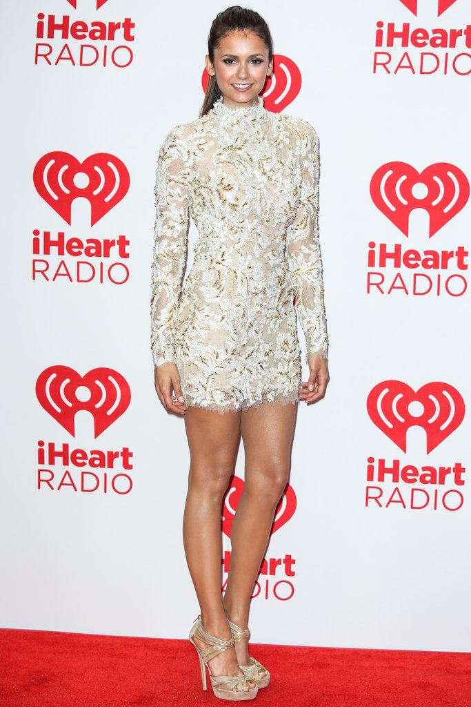 Nina Dobrev pulled out all the stops at September's iHeartRadio Music Festival, hitting the red carpet in a cream-coloured lace dress from Zuhair Murad's Couture collection.