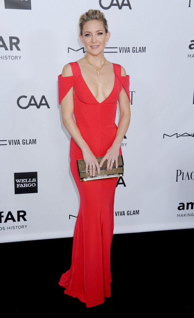 If you're headed to a black-tie affair, we can't think of better sartorial inspiration than Kate Hudson. Her bright red Prabal Gurung dress was super-sexy, yet classy. We suggest accessorising with a sparkly clutch and cocktail ring.