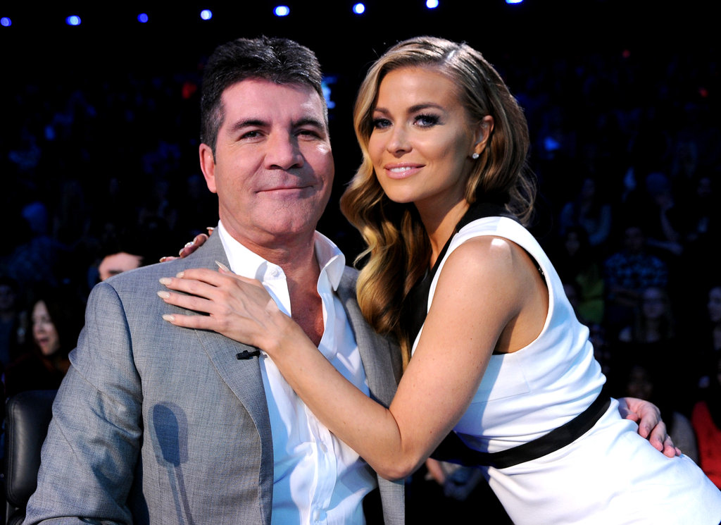 Simon Cowell posed with Carmen Electra.
