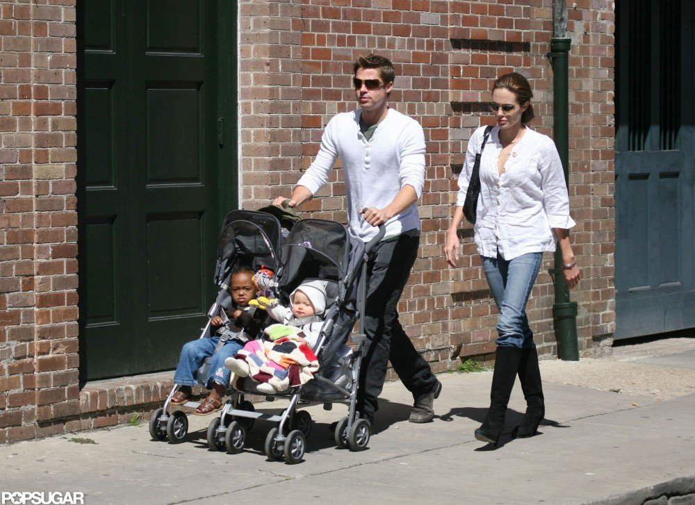 Brad Pitt and Angelina Jolie took daughters Zahara and Shiloh for a walk through their New Orleans neighborhood in March 2007.