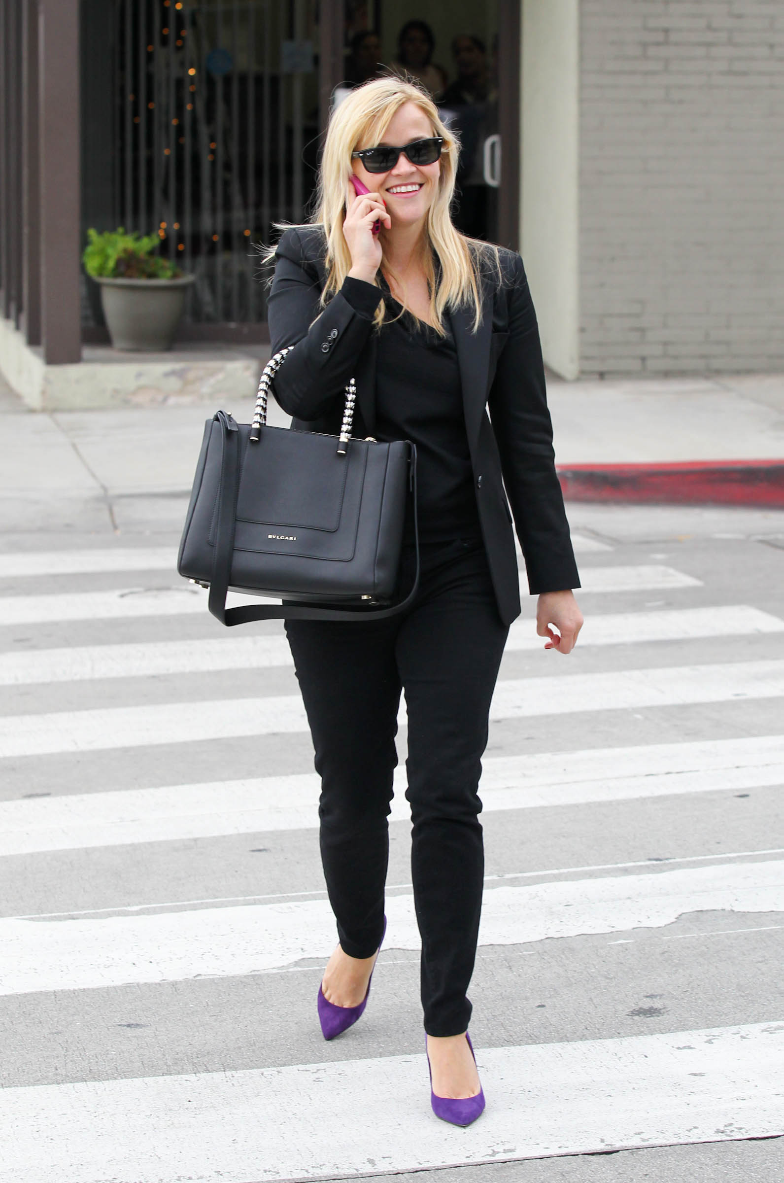 Reese Witherspoon wore purple pumps during a shopping day.