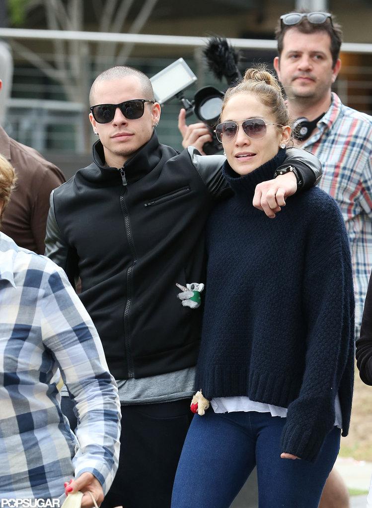 Casper Smart put his arm around Jennifer Lopez as they headed towards the yacht.