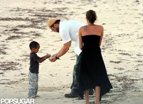Brad Pitt and Angelina Jolie built sand castles on the beach with little Maddox during a vacation in Africa back in April 2005.