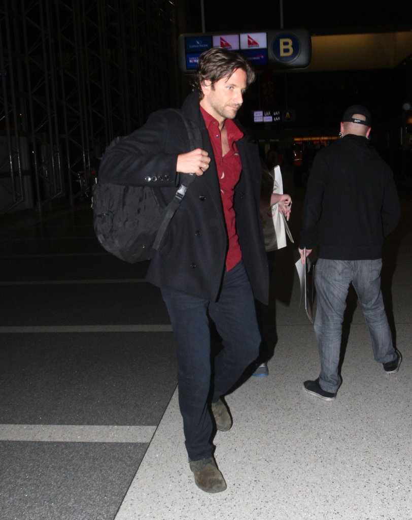 Bradley Cooper wore a red shirt to fly out of LAX.