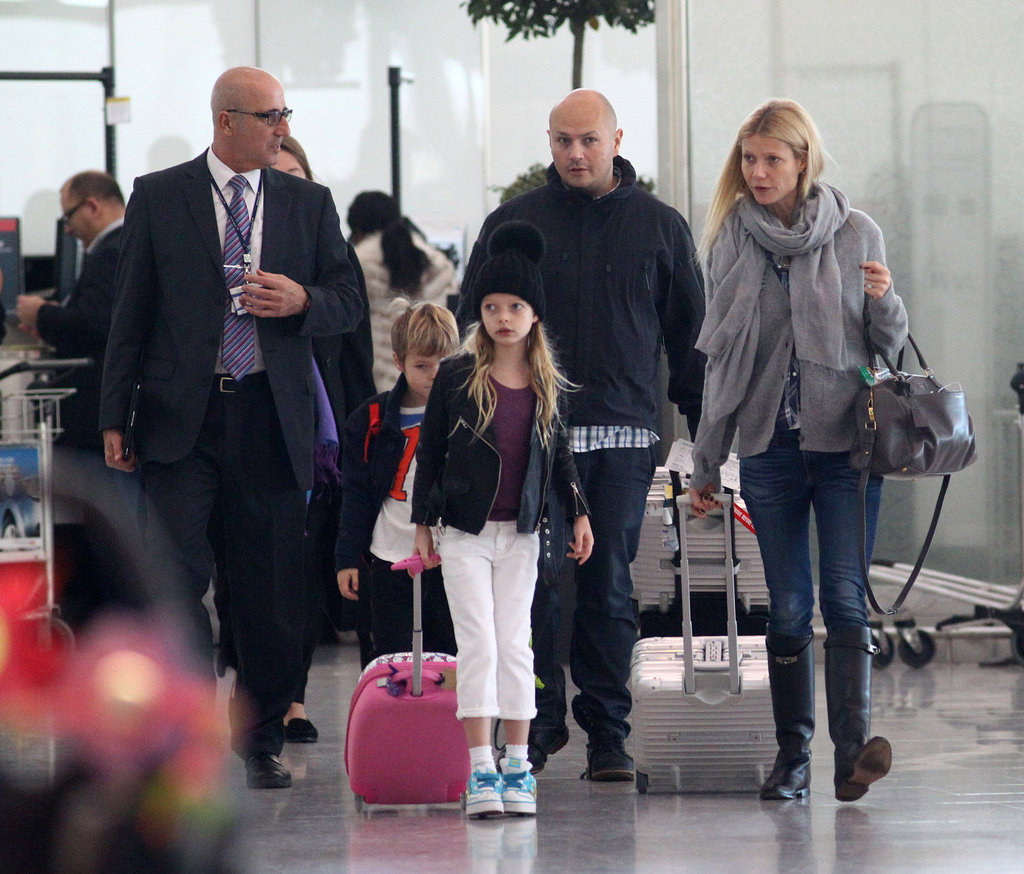 Gwyneth Paltrow walked through London's Heathrow airport with Apple Martin and Moses Martin.
