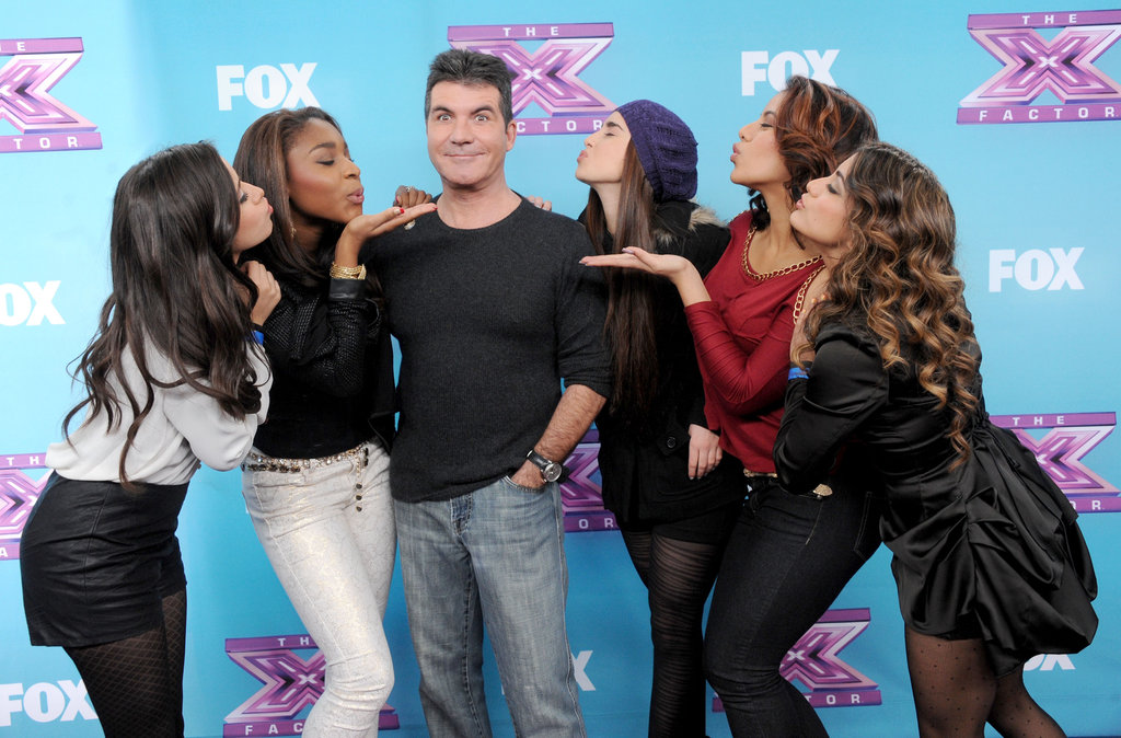 Simon Cowell got kisses from his finalist group, Fifth Harmony.