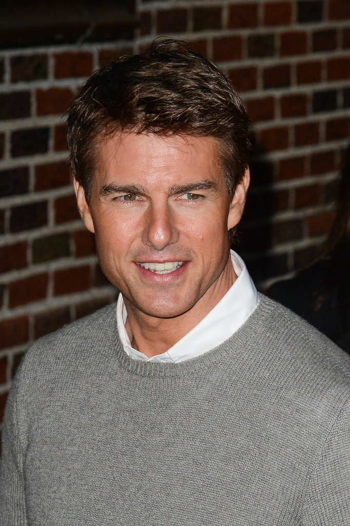 Tom Cruise looked dapper in a sweater and collared shirt.