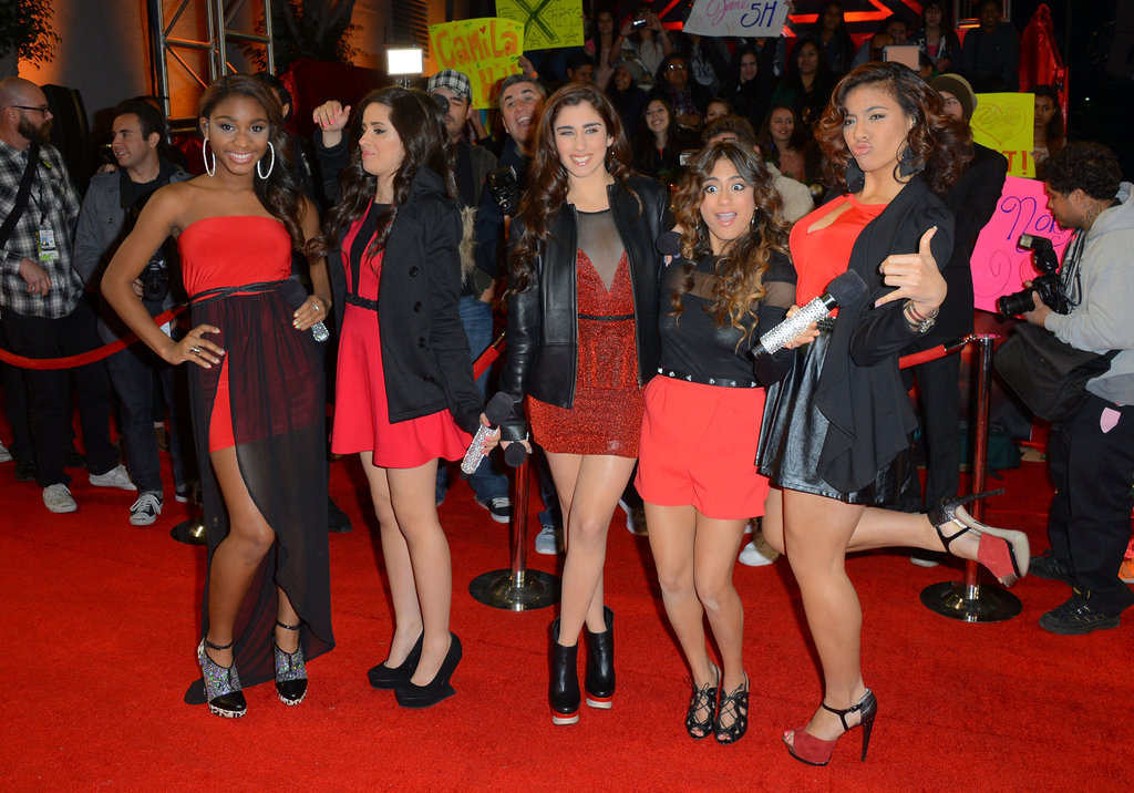 Fifth Harmony wore matching red and black outfits.