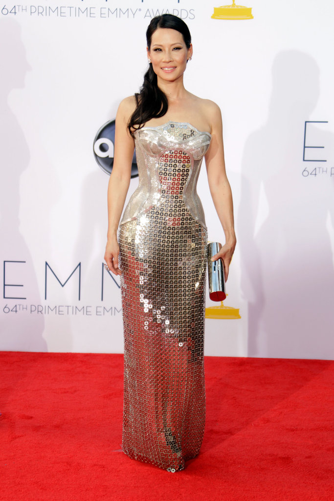 Lucy Liu donned a futuristic Versace column dress to the Emmys, and we think she nailed this riskier red-carpet gown choice.