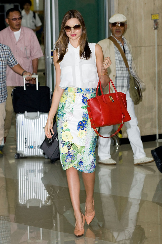 Miranda looked as fresh as one of the flowers on her Erdem skirt when she arrived in Seoul wearing a white, sleeveless Equipment blouse, which she paired with a floral pencil skirt. She accessorized her look with nude Lanvin pumps, a red Samantha Thavasa bag, and Miu Miu sunglasses.