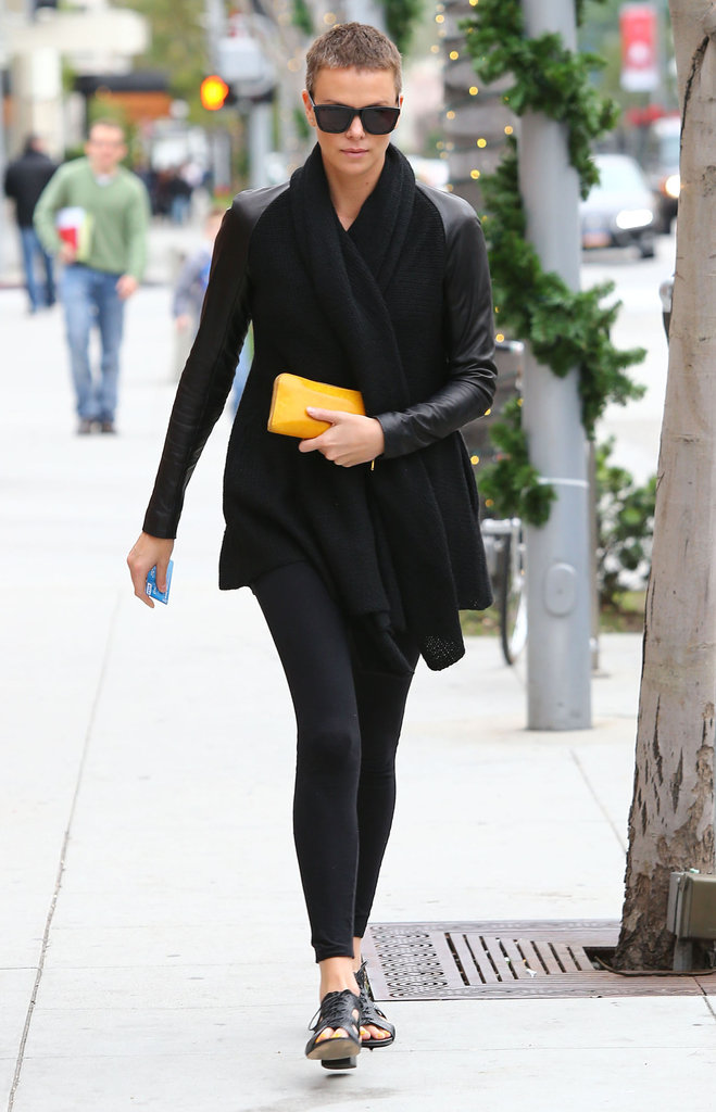Charlize Theron showed us how to wear all black without looking too severe — we love how she added a small yellow clutch for a chic, concentrated pop of color.
