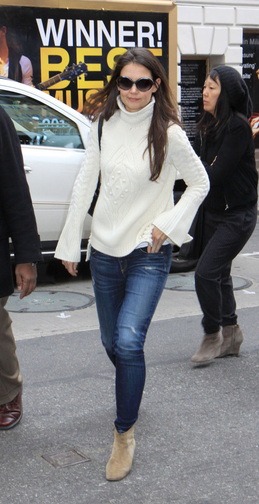 Katie Holmes perfected Winter classics in a white turtleneck, dark denim, and a pair of suede ankle boots.