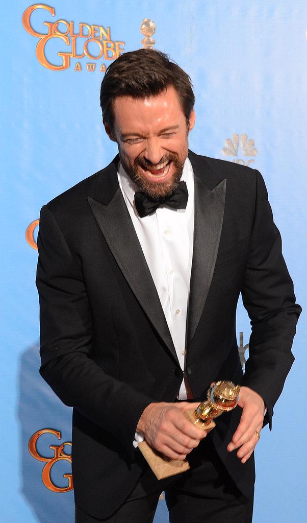Hugh Jackman held on to his trophy in the Golden Globes press room.